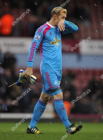 Swansea City goalkeeper Gerhard Tremmel looks dejected at the end of the game, having replaced goalkeeper Lukasz Fabianski who was sent off