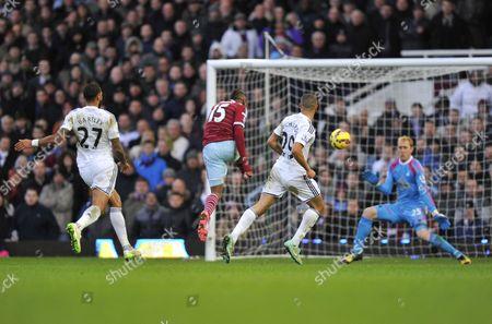 Diafra Sakho of West Ham United scores past Swansea City goalkeeper Gerhard Tremmel, 3-1