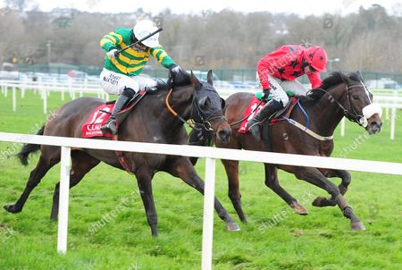 CORK JUMPTOCONCLUSIONS and Tony McCoy (Near) battle back to beat Old Time Melody (Far) to win for trainer Edward O'Grady. HEALY RACING