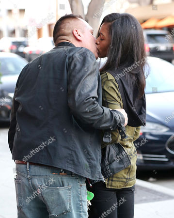 Stock Picture of Tom Sizemore and girlfriend
