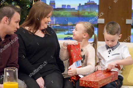 Jonathan and Debbie Watson with children Ryan (7) and Emma (5)