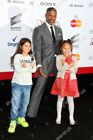 Jamie Foxx and Annalise Bishop (Right) with a friend