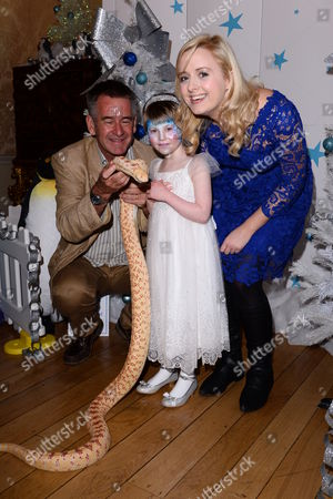 Nigel Marven, Katie Thistleton and child with a snake
