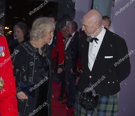 Camilla Duchess of Cornwall arrives and is greeted by Sun Editor David Dinsmore
