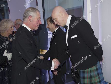 Prince Charles is greeted by Sun Editor David Dinsmore