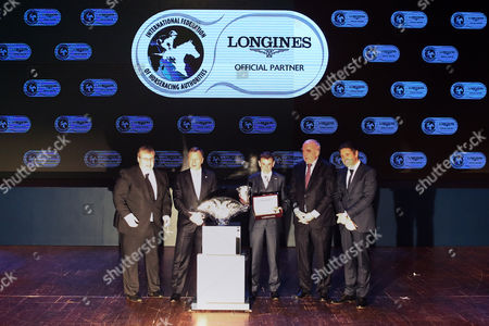 Hong Kong, , LONGINES World's Best Jockey Award Ceremony, from Left: Mr Juan-Carlos Capelli, Vice President of LONGINES and Head of International Marketing; Mr Walter von Känel, President of LONGINES International; Mr Ryan Moore; Mr Winfried Engelbrecht-Bresges, Vice-Chairman (Asia) of the International Federation of Horseracing Authorities and Chief Executive Officer of the Hong Kong Jockey Club; and Mr Brian Kavanagh, Vice Chairman (Europe) of the International Federation of Horseracing Authorities, smile for a group photo after the LONGINES World's Best Jockey Award Ceremony.