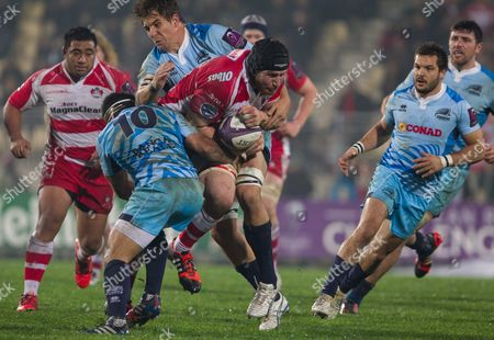 Ben Morgan of Gloucester punches his way through Luciano Orquera and Andries Van Schalwyk of Zebre. Zebre v Gloucester - Challenge Cup - 13/12/2014 - Stadio XXV Aprile - Parma, Italy. Mandatory Credit : Tim Rogers / Seconds Left / Rex