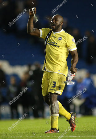 Danny Shittu Captain of Millwall celebrates with the fans at full time.