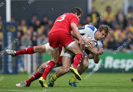 Clermont Auvergne's Aurelien Rougerie is tackled by Munster's Andrew Smith