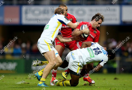 Clermont's Aurelien Rougerie and Noa Nakaitaci tackle Andrew Smith of Munster