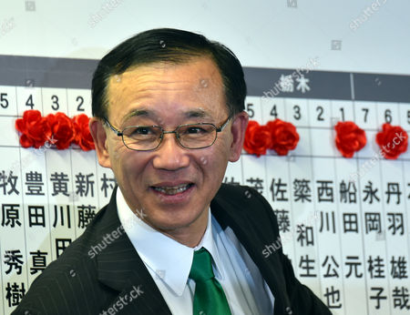 Secretary-General Sadakazu Tanigaki of the Liberal Democratic Party at the headquarters of the ruling Liberal Democratic Party as early returns from Sunday's general election indicate a landslide victory by the LDP