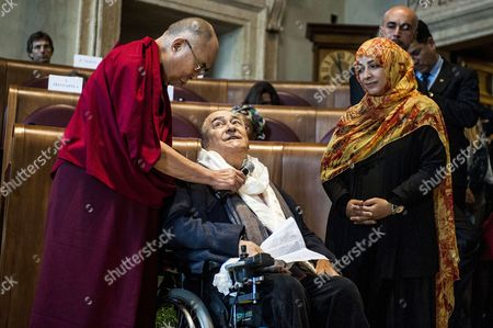 Dalai Lama and Tawakel Karman with the director Bernardo Bertolucci winner of Peace Summit Award 2014