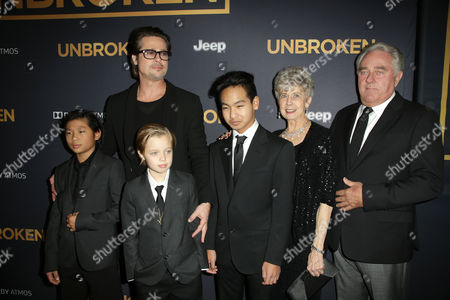 Stock Image of Brad Pitt with children Pax Jolie-Pitt, Shiloh Jolie-Pitt, Maddox Jolie-Pitt, and parents Jane Pitt and Bill Pitt