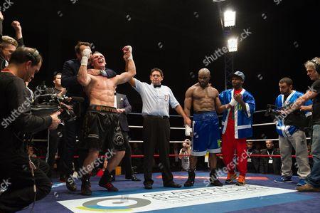 Mateusz Masternak celebrates after defeating Jean Marc Mormeck