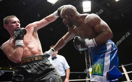 Jean Marc Mormeck,right, takes a punch from Mateusz Masternak, left