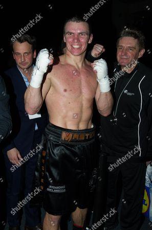 Mateusz Masternak celebrates after defeating Jean-Marc Mormeck
