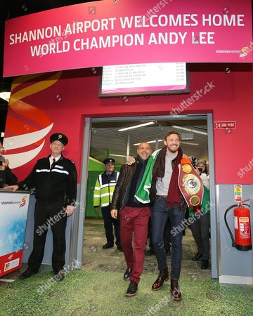 WBO Champion Andy Lee with trainer Adam Booth after arriving back in Shannon Airport with the belt