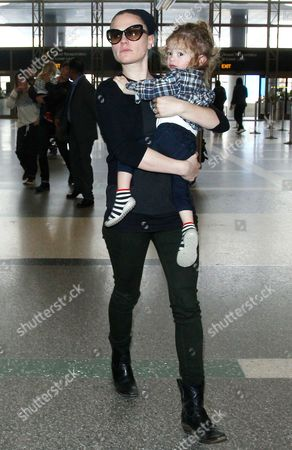 Editorial picture of Anna Paquin and Stephen Moyer at LAX airport, Los Angeles, America - 18 Dec 2014