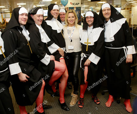 Abi Titmuss At Icap's 21st Annual Global Charity Day Got Underway With Brokers Dressing Up On The Trading Floor To Raise Money For 200 Charities Worldwide. Abbie Titmuss Joins Icap In Its London Office To Speak To Customers And Help Boost Trading Volumes For The Day. Icap Charity Day Has Raised More Than Ii100 Million For Over 1 400 Charities Since 1993.
