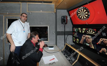 Sunni Upal Behind The Scenes At Pdc Darts. Pictured With Eric Bristow. Pdc World Darts Championship December 13th 2013.