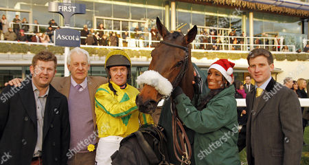 THE YOUNG MASTER (Barry Geraghty) with trainer Neil Mulholland (right) and owner Mike Burbidge (2nd left) after The Mappin & Webb Silver Cup Ascot