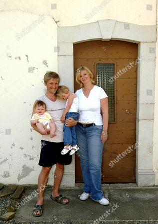 LAUREN BOOTH WITH HUSBAND CRAIG DARBY AND DAUGHTERS HOLLY (4 MONTHS) AND ALEXANDRA (2 YEARS)