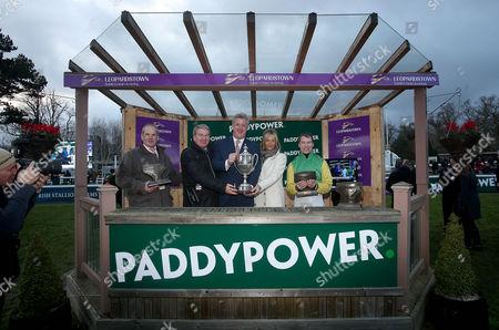 Stock Photo of Trainer Tony Martin, Owner John Breslin with his wife Debbie, Jockey Denis O'Regan and Patrick Kennedy of Paddy Power