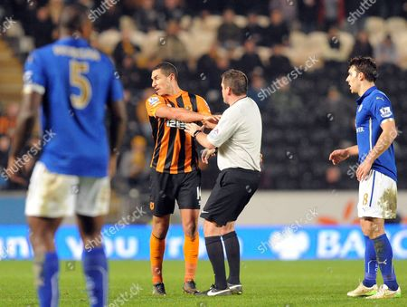 Jake Livermore of Hull City pushes Referee Phil Dowd when he gets in the way