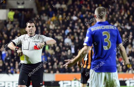 Referee Phil Dowd sends off Paul Konchesky of Leicester City