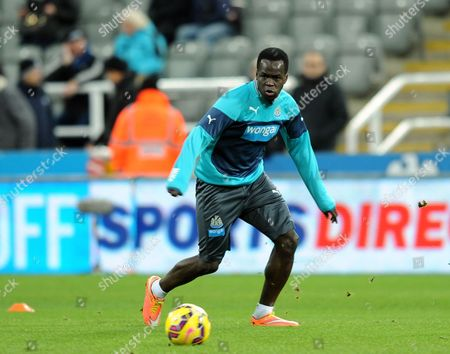 Cheik Tiote of Newcastle United returns to the starting line up and warms up before kick off