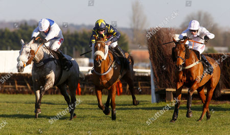 Knockanrawley and Jason Maguire (left) winning The Mandarin Handicap Chase from Back In June (right) and Finacial Climate (centre) Newbury