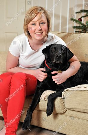 Diabetic Alice Halstead 22 At Her Home Near Skipton North Yorkshire With Her Medical Detection Dog 'holly' 3 Who Can Sense When Alice's Blood Sugar Levels Are Down And Licks Her Hand And Brings Medication As A Result.