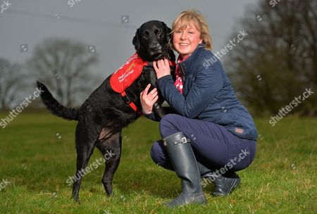 Xmas Keeper Diabetic Alice Halstead 22 At Her Home Near Skipton North Yorkshire With Her Medical Detection Dog 'holly' 3 Who Can Sense When Alice's Blood Sugar Levels Are Down And Licks Her Hand And Brings Medication As A Result.  19/12/13.