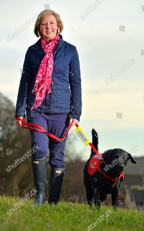 Stock Photo of Diabetic Alice Halstead 22 At Her Home Near Skipton North Yorkshire With Her Medical Detection Dog 'holly' 3 Who Can Sense When Alice's Blood Sugar Levels Are Down And Licks Her Hand And Brings Medication As A Result.