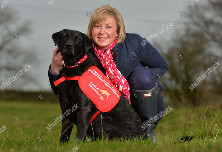 Editorial image of Diabetic Alice Halstead 22 At Her Home Near Skipton North Yorkshire With Her Medical Detection Dog 'holly' 3 Who Can Sense When Alice's Blood Sugar Levels Are Down And Licks Her Hand And Brings Medication As A Result.