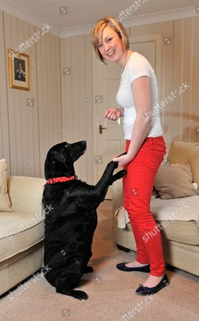 Stock Picture of Diabetic Alice Halstead 22 At Her Home Near Skipton North Yorkshire With Her Medical Detection Dog 'holly' 3 Who Can Sense When Alice's Blood Sugar Levels Are Down And Licks Her Hand And Brings Medication As A Result.