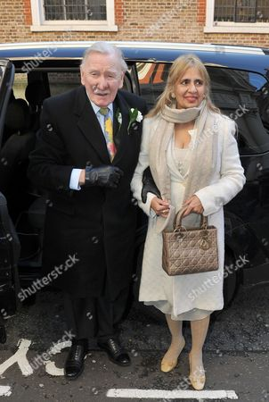 Dec 20 2013 - London England Uk - Giving A Joyful Thumbs Up Outside The Register Office Yesterday This Is Actor Leslie Phillips After He Married For The Third Time - At The Age Of 89. The Former Carry On Star Wed Turkish Social Worker Zara Carr 50 In Front Of Two Witnesses In Mayfair Central London. Afterwards Phillips Joked That His New Wife Shared The Same Name As The Queen's Granddaughter Zara Phillips. He Said: 'you Know What She Is Called Now? Zara Phillips! She's Royalty. But They Haven't Knighted Me Yet. It's About Time. (credit Image: Rob Todd/daily Mail/solo Syndication).