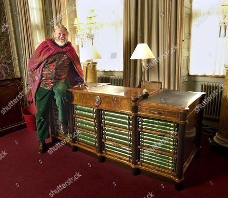 Lord Bath takes delivery of his spectacular new £30,000+ desk - thought to be one of the finest ever made in England - incorporating 7000 year old 'bog' oak along with five other native woods and shoat (cross between a sheep/goat) leather inlays. Bespoke furniture makers Senior and Carmichael took over 14 months to complete the commission. The front of the desk incorporates Lord Bath's collection of personal photographs - safely secured by a unique lock and key.
