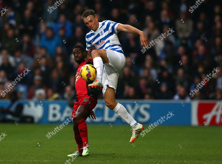 Clint Hill of Queens Park Rangers and Nathan Dyer of Swansea City in action
