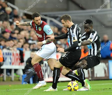 Danny Ings of Burnley (left) is forced off the ball from Paul Dummett of Newcastle United (centre) and Cheik Tiote of Newcastle United