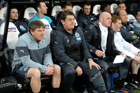 The Newcastle United bench post Alan Pardew (l-r) Peter Beardsley, Newcastle United caretaker manager John Carver and Steve Stone assistant coach of Newcastle United