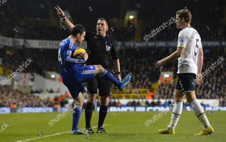 Cesc Fabregas of Chelsea complains to referee Phil Dowd about being kicked by Jan Vertonghen of Tottenham Hotspur