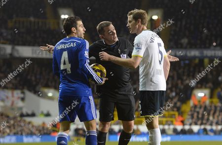 Referee Phil Dowd steps in to defuse a row between Cesc Fabregas of Chelsea and Jan Vertonghen of Tottenham Hotspur