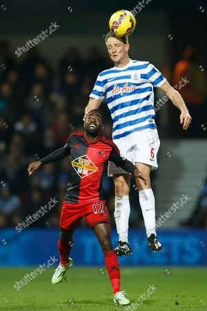 Clint Hill of QPR and Nathan Dyer of Swansea City