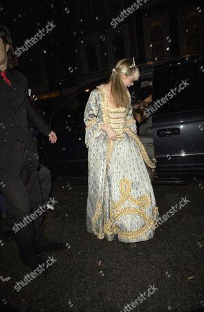LIZ MCCLARNON WITH HER DRESS CAUGHT IN THE DOOR OF HER PEOPLE CARRIER
