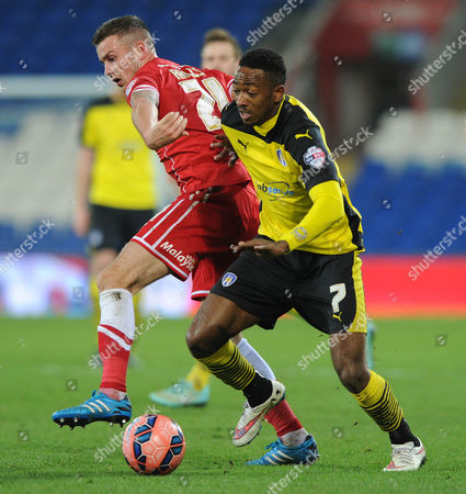 Stock Picture of Colchester United's Sanchez Watt  passes Cardiff City's Joe Ralls
