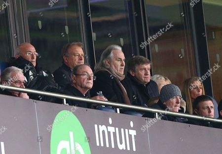 Stock Photo of New West Bromwich Albion head coach Tony Pulis (top left) watches from the stands with assistant Dave Kemp, Gerry Francis (2nd right), West Bromwich Albion technical director Terry Burton (right) and below him chairman Jeremy Peace and sporting director Richard Garlick (bottom right)