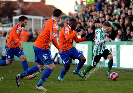Jarrett Rivers of Blyth Spartans (right) is tracked by Birmingham City players