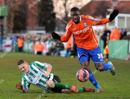 Daniel Maguire of Blyth Spartans is fouled by Guy Moussi of Birmingham City
