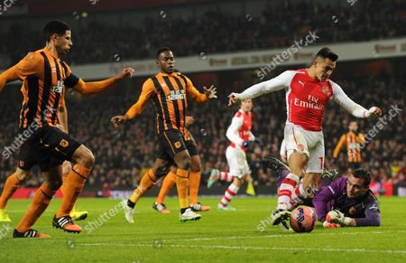 Alexis Sanchez of Arsenal attempts to shoot around Hull City Goalkeeper Steve Harper